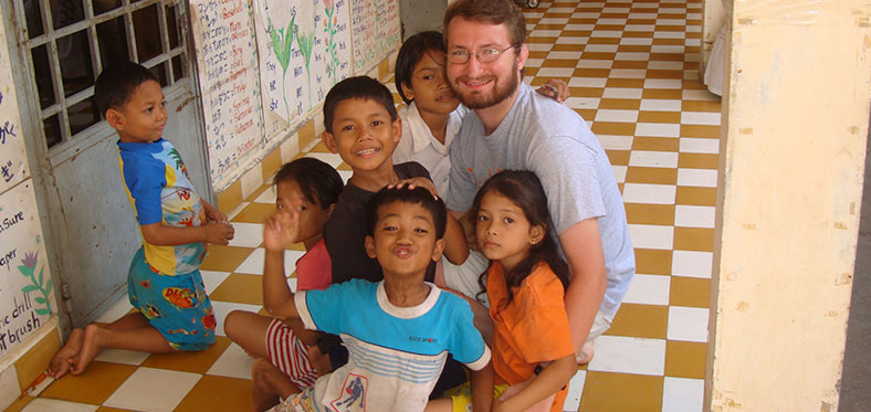 Volunteer teacher with students in Cambodia