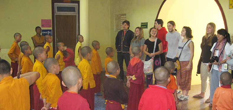 Buddhist monks with a volunteer