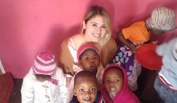 Happy children relishing with a volunteer